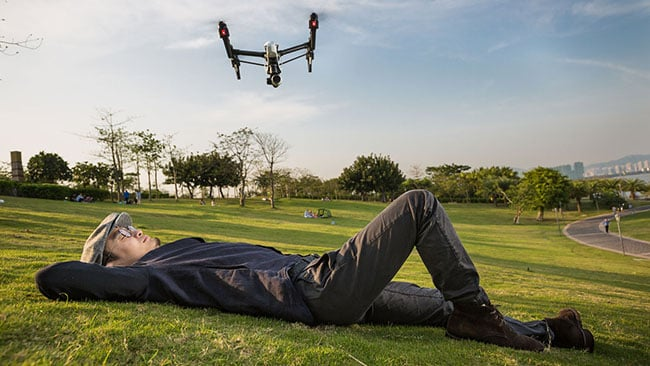 Frank Wang DJI founder in park with drone
