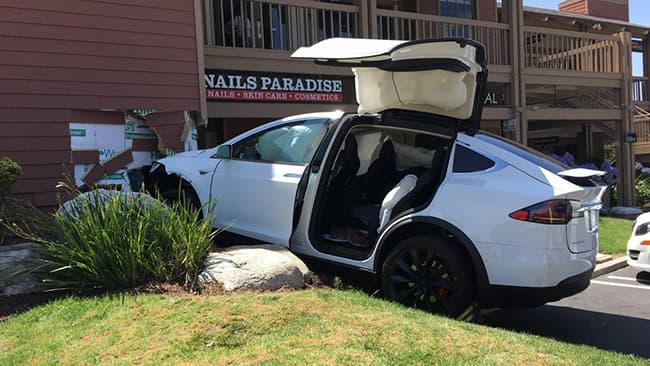 photo of crash involving white Tesla