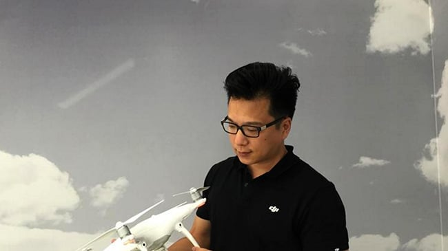Photo of DJI engineer holding drone